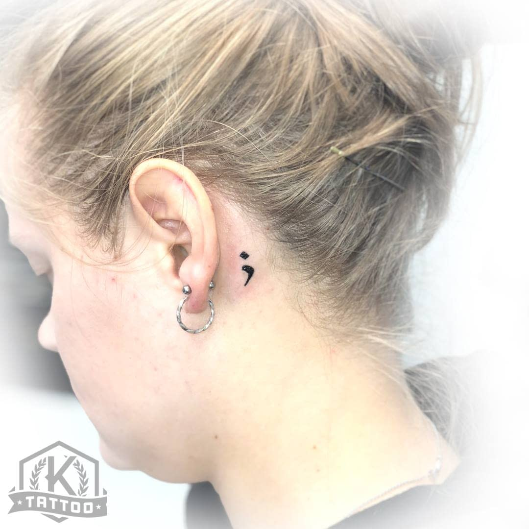 blackandgrey_semi_colon_behind_ear